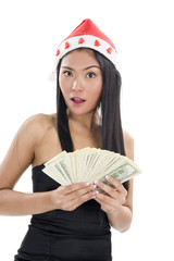 woman with santa claus hat and money
