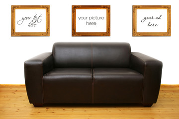 brown leather sofa and blank photo frames on the wall