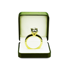 Engagement ring in box on white