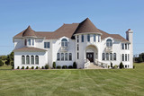 Luxury white home with front turret poster
