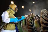 sandblast worker in the workshop - 27865864