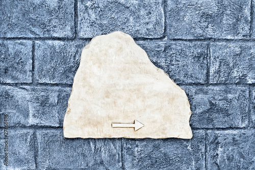 Empty marble street sign on rough color brick wall