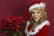 Weihnachtsstern-Frau in  Santa Claus Bekleidung.