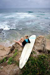 Surfer girl sitting