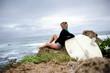 Surfer girl sitting
