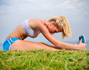 Blond girl stretches