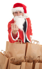 man in Santa clothes with paper bags