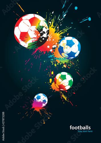 Kolorowe futbolowe na czarnym tle
