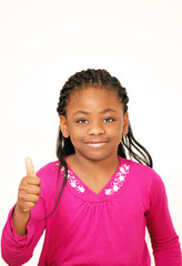 Smiling young girl thumbs up sign