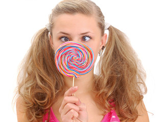 pretty teenage girl with a lollipop