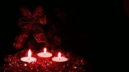 Lighted candles on a red background