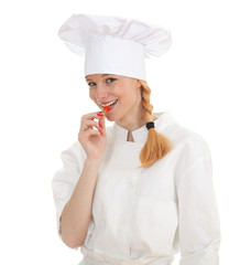 young chef woman trying to eat chilli, pepperoni