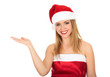 Pretty girl wearing red Christmas hat, holding a hand palm up.