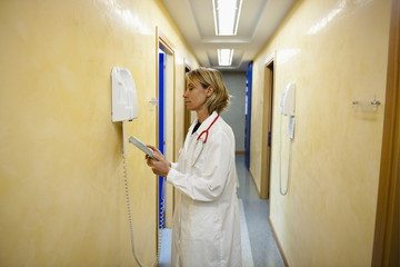 Doctor making telephone call in medical center