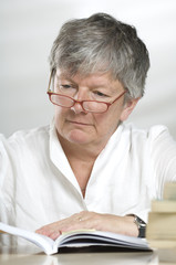 Adult women studying while reading a book
