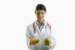Doctor holding apple and hand weights