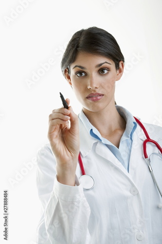 Doctor writing with pen