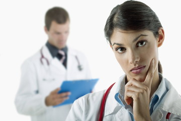 Doctor thinking and doctor reading medical chart