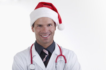 Doctor with stethoscope and Santa's hat