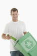 Man throwing glass bottle in the recycling bin