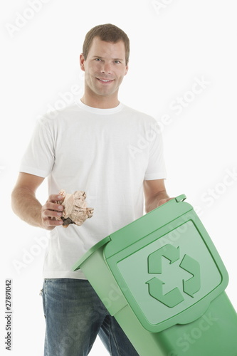 Man throwing paper in the recycling bin