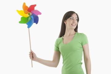 Young woman holding pinwheel