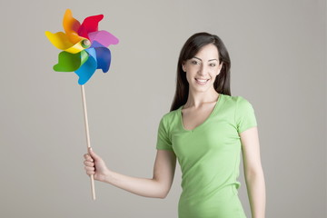 Young woman holding pinwheel