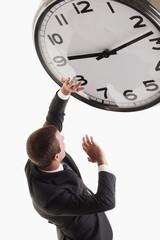 Man underneath clock