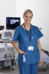 Ultrasound technician standing with equipment