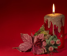 Christmas candle and poinsettia.