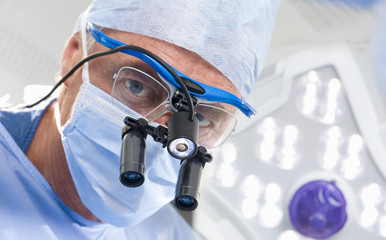 Concentrating surgeon performing operation in operating room