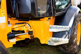 Yellow Hydraulic Excavator Articulation Mechanism Side View poster