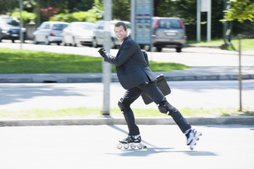 Businessman in suit inline skating