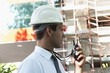 Man with hardhat and walky talky radio at construction site