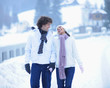 Happy young couple walking together on winter day