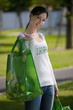 Casual woman with reusable shopping bags