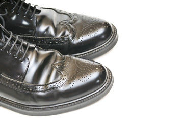 pair of mens black leather shoes