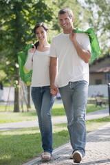 Couple with reusable shopping bags outdoor
