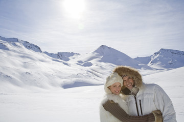 Portrait of young couple in mountains on winter day