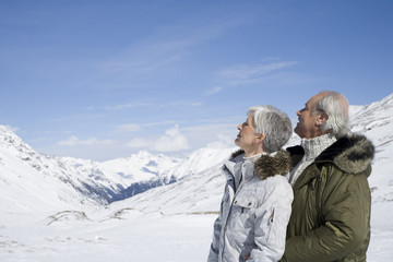 Senior couple enjoying the mountain view on winter day