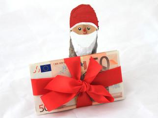 Weihnachsmann  mit Geldschein