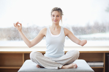 Young woman with amputee arm in yoga pose