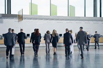 Delegates walking towards the check-in desks a conference centre
