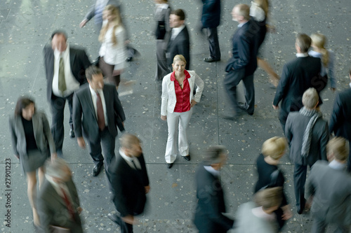 A woman standing in a crowd of businesspeople