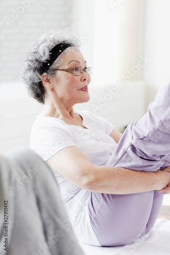 A senior woman in an exercise class