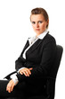 Portrait of serious business woman sitting on office chair