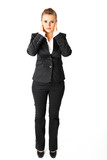 Modern business woman with hand on ears isolated on white.