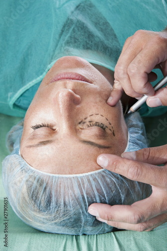 Incision lines on face in operating room
