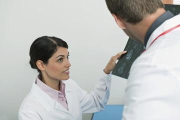 Doctors looking at an MRI