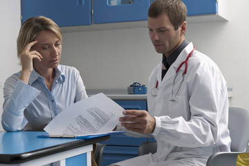 Doctor and patient looking at document